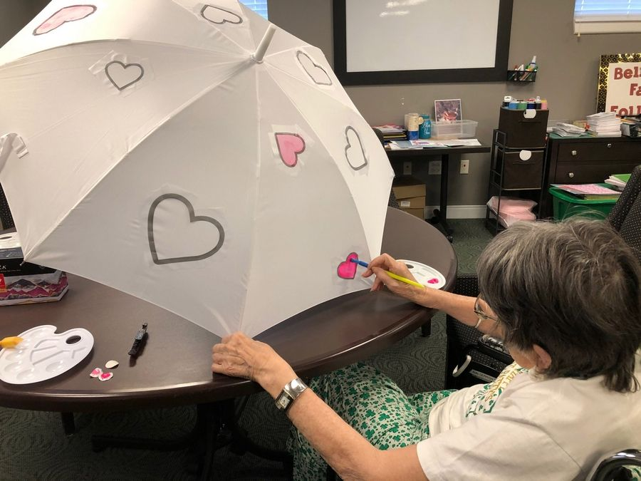 Belmont Village Glenview resident paints umbrella